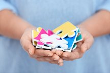 bigstock-Woman-holding-pieces-of-colorf-214635574